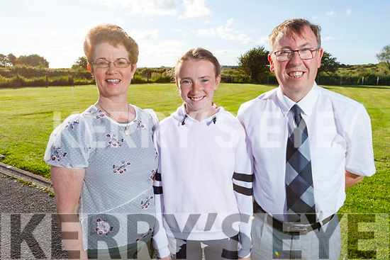 Rebecca O'Mahoney from Abbeydorney graduating from Abbeydorney NS on Monday night standing with her dad and mom Mary and Alan O'Mahoney.