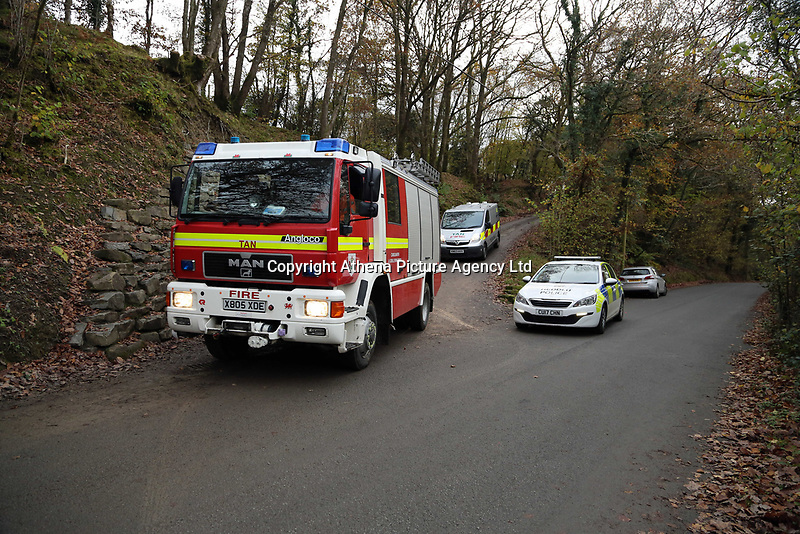 Pictured: A fire engine leaves the house that burned in Llangammarch Wells, Powys, Wales, UK. Tuesday 31 October 2017<br />Re: Investigations continue into a house fire in which a father and several of his children have died.<br />Three children aged 13, 12 and 10 escaped the farmhouse in Llangammarch Wells, Powys, in the early hours of Monday and raised the alarm.<br />Police said they could not identify the deceased or confirm numbers.<br />One of those missing has been named locally as David Cuthbertson.