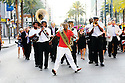 """Secondline in French Quarter, featuring Darryl """"Dancing Man 504"""" Young, 2011"""