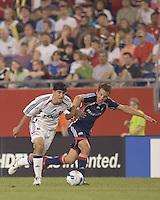 Alecko Eskandarian (Real Salt Lake, white) dribbles as Bryan Bryne (Revolution, blue) defends. New England Revolution played Real Salt Lake to a 0-0 tie, at Gillette Stadium on June 2, 2007.