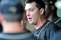 Head coach Todd Interdonato of the Wofford Terriers rallies the team in the dugout in the ninth inning in a SoCon Tournament game against Western Carolina on Wednesday, May 25, 2016, at Fluor Field at the West End in Greenville, South Carolina. Western won, 10-9. (Tom Priddy/Four Seam Images)