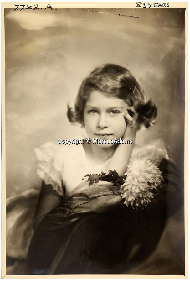 BNPS.co.uk (01202 558833)<br /> Pic: MarcusAdams/ChiswickAuctions/BNPS<br /> <br /> Princess Elizabeth at 8 years old.<br /> <br /> Charming childhood photos of Princess Elizabeth and Princess Margaret have come to light, including a previously unseen image of the future Queen in a kilt.<br /> <br /> The portraits, taken by acclaimed British society photographer Marcus Adams, capture the future Queen from being a baby to her adolescence.<br /> <br /> The Queen Mother would often take her daughters to his central London studio where he would set up toys and props to keep them entertained