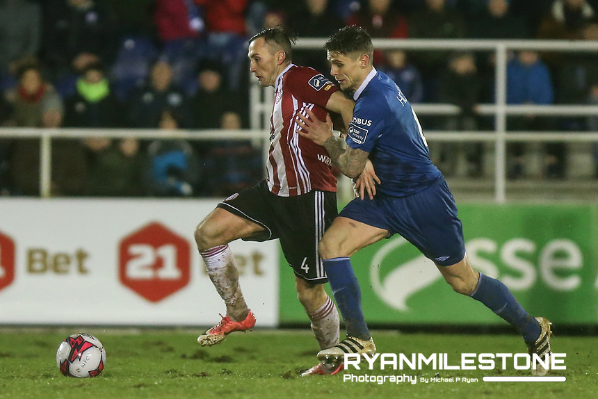 Aaron McEneff of Derry in action against Gavan Holohan of Waterford during the SSE Airtricity League Premier <br /> Division game between Waterford FC and Derry City on Friday 16th February 2018 at the RSC Waterford. Photo By: Michael P Ryan
