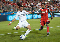 Vancouver Whitecaps FC forward Camilo Sanvezzo #37 and Toronto FC defender Ashtone Morgan #5 in action during an MLS game between the Vancouver Whitecaps FC and the Toronto FC at BMO Field in Toronto on June 29, 2011..Toronto FC won 1-0..