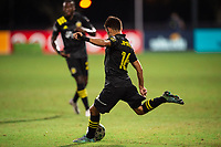 LAKE BUENA VISTA, FL - JULY 16: Hector Jimenez #16 of the Columbus Crew SC kicks the ball during a game between New York Red Bulls and Columbus Crew at Wide World of Sports on July 16, 2020 in Lake Buena Vista, Florida.