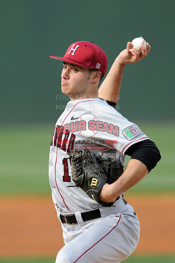 Starting pitcher Nick Gruener (17) of the Harvard Crimson delivers a pitch in a game against the Michigan State Spartans on Saturday, March 15, 2014, at Fluor Field at the West End in Greenville, South Carolina. Michigan State won, 4-0. (Tom Priddy/Four Seam Images)