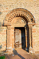 Norman Romanesque relief sculptures of dragons and mythical creatures depicting the struggle between good and evil, from the South doorway of Church of St Mary and St David, Kilpeck Herifordshire, England. Built around 1140