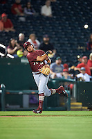 Frisco RoughRiders shortstop Edwin Garcia (11) throws to first during a game against the Springfield Cardinals on June 3, 2015 at Hammons Field in Springfield, Missouri.  Springfield defeated Frisco 7-2.  (Mike Janes/Four Seam Images)