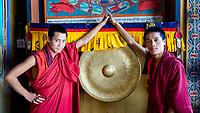Friendly young buddhist monks pose at Trongsa Dzong, Bhutan