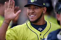 Pitcher Simeon Woods-Richardson (21) of the Columbia Fireflies is greeted after a scoreless first inning in a game against the Charleston RiverDogs on Thursday, April 4, 2019, at Segra Park in Columbia, South Carolina. Charleston won, 2-1. (Tom Priddy/Four Seam Images)