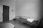 Prison cell UK 1980s. Prisoners unmade bed empty, ready for  use. HM Prison Styal Wilmslow Cheshire 1986.