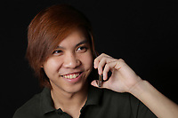 MODEL RELEASED - Asian (Filipino) 17 years old male teenager<br /> with a smart phone