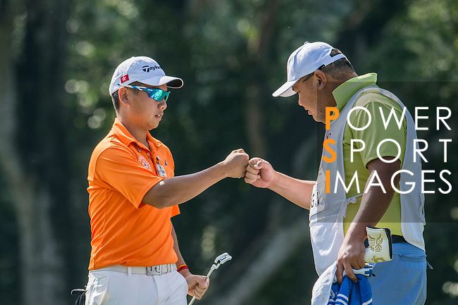Humphrey Wong of Hong Kong bumps fists with his caddie during the 58th UBS Hong Kong Golf Open as part of the European Tour on 09 December 2016, at the Hong Kong Golf Club, Fanling, Hong Kong, China. Photo by Marcio Rodrigo Machado / Power Sport Images