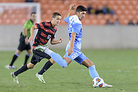 Houston, TX - Friday December 9, 2016: Mauricio Pineda (2) of the North Carolina Tar Heels clears the ball against the Stanford Cardinal at the NCAA Men's Soccer Semifinals at BBVA Compass Stadium in Houston Texas.