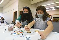 CHRISTMAS IN THE MAKING<br />Lauren Nelson and her daughter, Hope, 8, make Christmas ornaments on Saturday Nov. 14 2020 at Rogers Experimental House in downtown Rogers. Materials, including paint, tinsel and decorative items, were provided. Sue Mandel, owner of The Makery NWA helped ornament creators with their projects. The Makery NWA hosts a variety of crafts classes through the year at Rogers Experimental House, Mandel said. Go to nwaonline.com/201115Daily/ to see more photos.<br />(NWA Democrat-Gazette/Flip Putthoff)