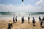 Men kick a soccer ball back and forth on a public beach near Aden, Yemen, Dec. 2, 2009. Lawlessness, growing poverty, a water crisis, a raging conflict with Houthi rebels in Yemen's north and clashes with separatists in the South continue to destabilize the Arabian Peninsula's poorest state.