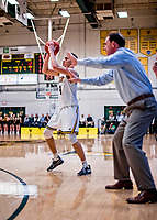 9 February 2019: University of Vermont Catamount Guard Robin Duncan, a Freshman from Evansville, IN, sets up to shoot for three as the University at Albany Great Danes Head Coach Will Brown gives coaching on-court at Patrick Gymnasium in Burlington, Vermont. The Catamounts defeated the Danes 67-49 in their America East matchup. Mandatory Credit: Ed Wolfstein Photo *** RAW (NEF) Image File Available ***