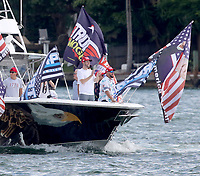MIAMI, FL - OCTOBER 15: Hundreds of boats showed up for a massive show of support even in the pouring rain as the President's son Eric Trump and wife Lara lead a  pro-Trump Flotilla rally in Miami, Florida on October 15, 2020 just 19 days ahead of the election the turnout was massive and was in the pouring rain  Credit: Hoo-me / MediaPunch