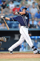 Asheville Tourists designated hitter Max White #13 swings at a pitch during opening night game against the Delmarva Shorebirds at McCormick Field on April 3, 2014 in Asheville, North Carolina. The Tourists defeated the Shorebirds 8-3. (Tony Farlow/Four Seam Images)