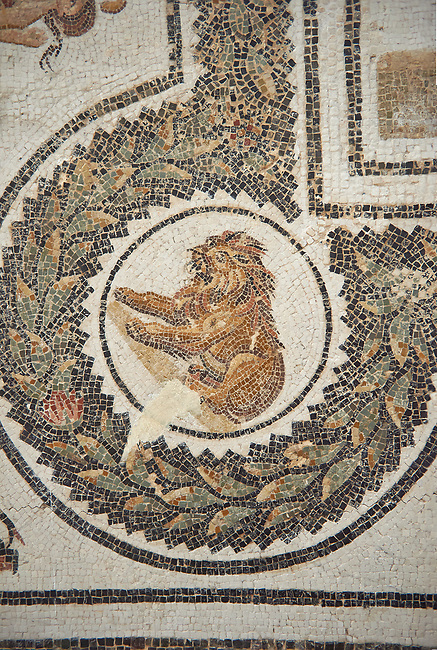 Detail picture of the corner medalion with a lion from the Roman mosaics design depicting Dionysus Riding a Panther, from Abdel Jelil. 2nd century AD. El Djem Archaeological Museum, El Djem, Tunisia.
