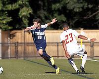University of Rhode Island (URI) midfielder Matt Ribbens (13) works to clear ball. Boston College defeated University of Rhode Island, 4-2, at Newton Campus Field, September 25, 2012.