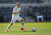 LOS ANGELES, CA - APRIL 17: Alex Ring #8  of Austin FC moves with the ball during a game between Austin FC and Los Angeles FC at Banc of California Stadium on April 17, 2021 in Los Angeles, California.