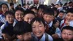 An array of smiling school children in Zigui China