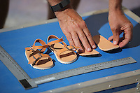 FAO JANET TOMLINSON, DAILY MAIL PICTURE DESK<br />Pictured: CSI Forensics officer Frank Harkness presents a copy of a pair of sandals similar to those worn by Ben Needham in Kos, Greece. Saturday 01 October 2016<br />Re: Police teams led by South Yorkshire Police, searching for missing toddler Ben Needham on the Greek island of Kos have moved to a new area in the field they are searching.<br />Ben, from Sheffield, was 21 months old when he disappeared on 24 July 1991 during a family holiday.<br />Digging has begun at a new site after a fresh line of inquiry suggested he could have been crushed by a digger.