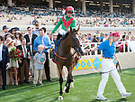 August 20, 2011 .Summer Soiree ridden by Gabriel Saez in the winner's circle after winning the Del Mar Oaks to Del Mar Thoroughbred Club, Del Mar, CA.