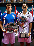 BANGKOK, THAILAND - OCTOBER 03:  Guillermo Garcia-Lopez of Spain and Jarkko Nieminen of Finland pose with their trophies at the end of the singles final match during the Day 9 of the PTT Thailand Open at Impact Arena on October 3, 2010 in Bangkok, Thailand.  Photo by Victor Fraile / The Power of Sport Images