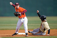 Second baseman Michael Seaborn #5 of the Virginia Tech Hokies turns a double play against the Wake Forest Demon Deacons at English Field March 27, 2010, in Blacksburg, Virginia.  Photo by Brian Westerholt / Four Seam Images