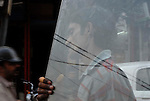 Man carrying sheet of glass in the Paharganj district of New Delhi, India.