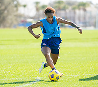 ORLANDO, FL - JANUARY 20: Crystal Dunn #19 of the USWNT dribbles during a training session at the practice fields on January 20, 2021 in Orlando, Florida.