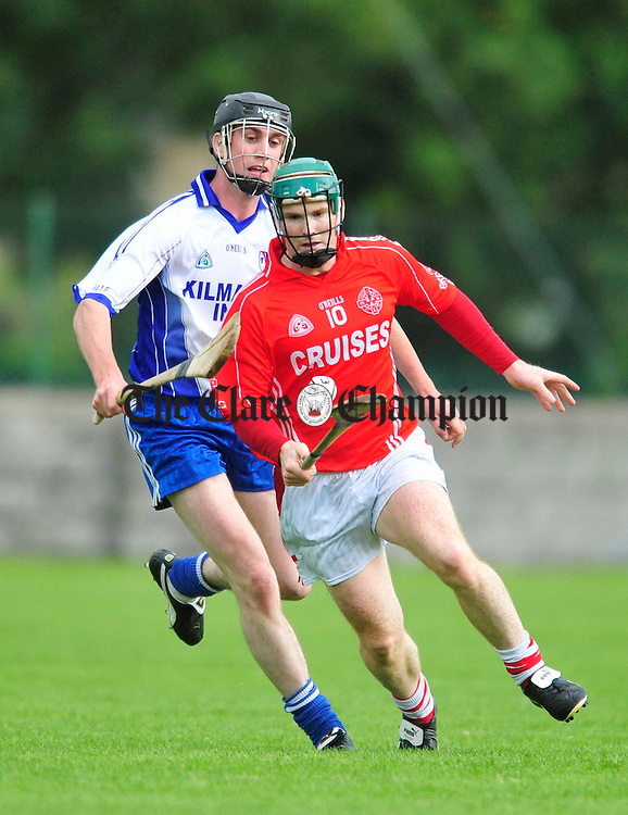 Eire Og's Adrian Flaherty and Kilmaley's Vincent Kileen. Photograph by Declan Monaghan