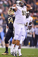 January 01, 2014:<br /> <br /> UCF Knights defensive lineman E.J. Dunston #95 reacts after sacking Baylor Bears quarterback Bryce Petty #14 during Tostitos Fiesta Bowl at University of Phoenix Stadium in Scottsdale, AZ. UCF defeat Baylor 52-42 to claim it's first ever BCS Bowl trophy.