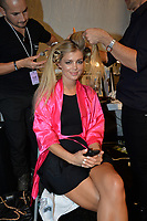 MIAMI, FL - JULY 18: A model prepares backstage at the Beach Bunny Featuring The Blonds show during Mercedes-Benz Fashion Week Swim 2015 at Cabana Grande at The Raleigh on July 18, 2014 in Miami, Florida. <br />