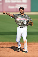 Arkansas Travelers shortstop Maikol Gonzalez (5) warmup throw to first during a game against the San Antonio Missions on May 25, 2014 at Dickey-Stephens Park in Little Rock, Arkansas.  Arkansas defeated San Antonio 3-1.  (Mike Janes/Four Seam Images)