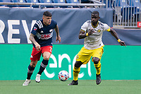 FOXBOROUGH, MA - MAY 16: Gustavo Bou #7 of New England Revolution drives the ball to the midfield during a game between Columbus SC and New England Revolution at Gillette Stadium on May 16, 2021 in Foxborough, Massachusetts.