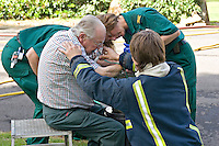 Firefighters and Paramedics treating an elderly gentleman who has severe burns to his arms and hands with waterjel. The man had tried to install a calor gas cylinder to close to an open flame which then blew up. This image may only be used to portray the subject in a positive manner..©shoutpictures.com..john@shoutpictures.com