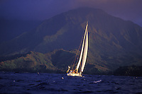 Family sailing a 48 foot cruising yacht off Hanalei bay, north Shore of Kauai, Hawaii