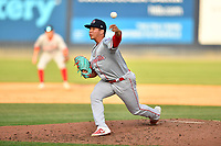 Greenville Drive pitcher Oddanier Mosqueda (7) delivers a pitch during a game against the Asheville Tourists on May 22, 2021 at McCormick Field in Asheville, NC. (Tony Farlow/Four Seam Images)