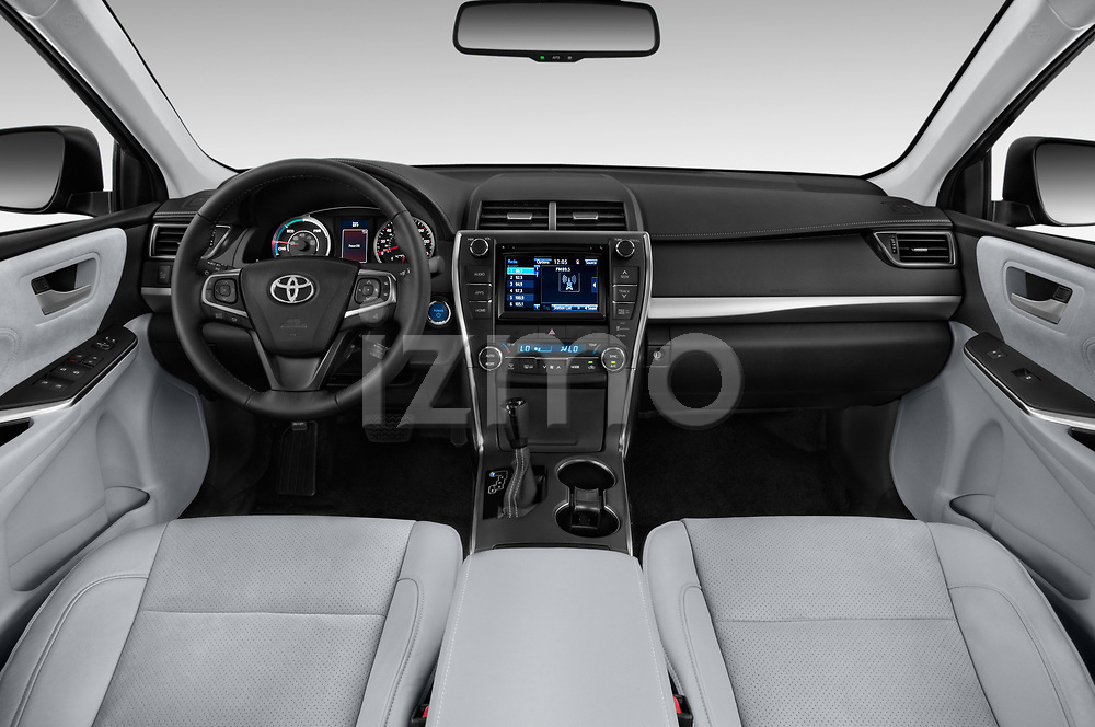 Stock photo of straight dashboard view of a 2015 Toyota camry hybrid 4 Door Sedan
