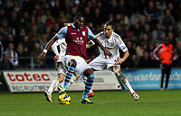 Tuesday 01 January 2013<br /> Pictured: (L-R) Christian Benteke, Chico Flores.<br /> Re: Barclays Premier League, Swansea City FC v Aston Villa at the Liberty Stadium, south Wales.