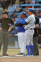 Asheville Tourists manager Fred Ocasio #28, Lexington Legends manager Brian Buchanan #44 and umpire Blake Carnahan before a game between the Lexington Legends and the Asheville Tourists at McCormick Field on April 23, 2013 in Asheville, North Carolina. The Tourists won the game 4-3. (Tony Farlow/Four Seam Images).