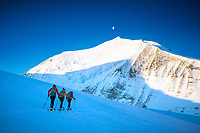 Ski touring on a glacier beneath the northeast face of the Bishorn, on the way to the Brunegghorn, Switzerland
