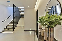 BNPS.co.uk (01202) 558833<br /> Pic: Savills/BNPS<br /> <br /> The stunning home has over 7,000 sq ft of living space<br /> <br /> A striking high-tech eco home that would not look out of place in a Bond film is on the market for offers over £4m.<br /> <br /> Skyfall is a luxurious house in the Berkshire countryside designed to be totally carbon free.<br /> <br /> With its luxe white interiors, minimalist decor and stunning countryside surroundings, the five-bedroom property would fit effortlessly into 007's world.<br /> <br /> But it's the eco features of the brand new house, which is just outside the village of Taplow with Huntswood Golf Course next door, that make it really stand out.