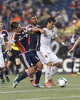 Real Salt Lake midfielder Javier Morales (11) on the attack fends off New England Revolution midfielder Ryan Guy (13).