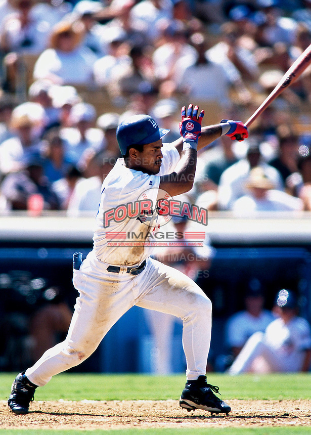 Raul Mondesi of the Los Angeles Dodgers during a game at Dodger Stadium in Los Angeles, California during the 1997 season.(Larry Goren/Four Seam Images)