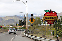 A sign welcomes visitors in Wenatchee, WA on April 13, 2018. (Photo by Karen Ducey Photography)