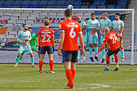 Kal Naismith of Luton Town (R) takes a free kick over the Swansea wall during the Sky Bet Championship match between Luton Town and Swansea City at Kenilworth Road, Luton, England, UK. Saturday 13 March 2021
